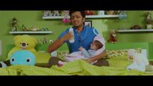 Amar feeding the baby