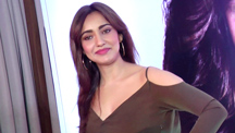 Neha Sharma promises a 'sneak peek' into her life